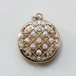 Antique Edwardian Tiffany and Co Diamond Set 20ct Gold Round Locket; diagonal, geometric and floral decoration, mille griffe set old-cut diamonds, Signed