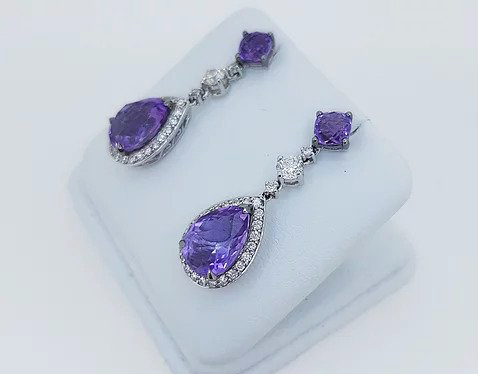 Amethyst and Diamond Pear Shaped Cluster Drop Earrings; pear-shaped rose-cut amethyst and diamond cluster suspended by an amethyst stud, via a brilliant cut diamond. Mounted in 18ct white gold.