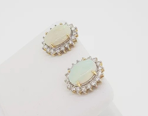 Opal and Diamond Oval Cluster Stud Earrings; featuring 4.00cts oval cabochon opals surrounded by sparkling diamonds, claw set in 18ct gold