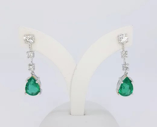 Pear Shaped Emerald and Diamond Drop Earrings; 3.95cts pear-shaped emeralds suspended from 0.89ct graduated diamond drop, 18ct white gold