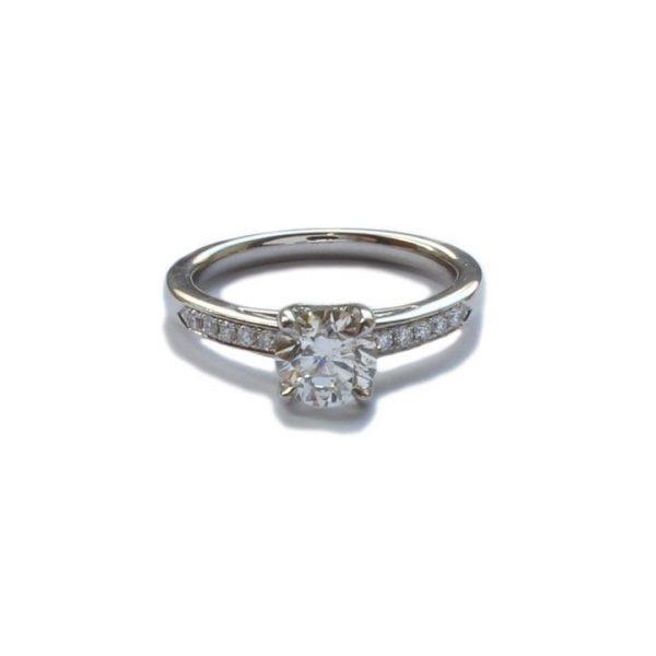 1.00ct Diamond and Platinum Engagement Ring; solitaire 1.00 carat brilliant cut diamond, G colour, VS2 clarity, diamond set shoulders, With certificate