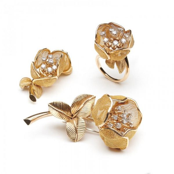 Vintage Piaget 18ct Gold and Diamond Flower Suite, comprising a ring and two brooches, articulated gold mesh set with diamonds, Circa 1960