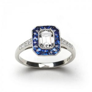 0.69ct Emerald Cut Diamond and Sapphire Cluster Ring in Platinum