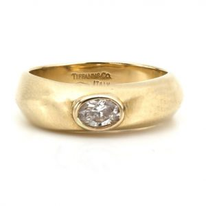 Vintage Tiffany and Co 0.33ct Diamond and 18ct Yellow Gold Ring; set with a 0.33ct oval-cut diamond, Made in Italy, Import London Hallmarks, 2001