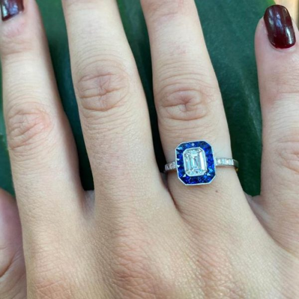 0.69ct Emerald Cut Diamond and Sapphire Cluster Ring, set in platinum