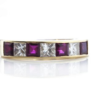 Garrard Princess Cut Ruby and Diamond Half Eternity Ring, 0.64ct princess-cut rubies and 0.48cts princess-cut diamonds, in 18ct Yellow Gold