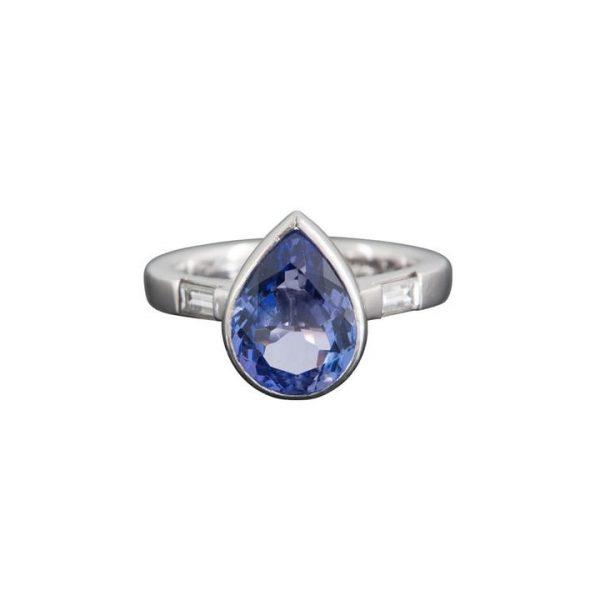 4.13ct Pear Shaped Tanzanite and Diamond Ring; central 4.13 carat pear-shaped tanzanite flanked by 0.39cts baguette-cut diamonds, in platinum