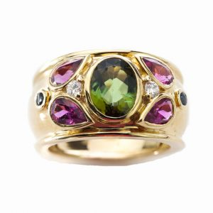 Cartier Multi Gem set 18ct Yellow Gold Ring, set with green tourmaline, pink tourmalines, sapphires and diamonds. Signed, 1994, with original box.