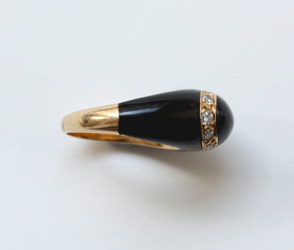 Van Cleef and Arpels Onyx, Diamond and 18ct Yellow Gold Fidji Ring; Signed and numbered Van Cleef & Arpels, Model Fidji, 0.51 carat total.