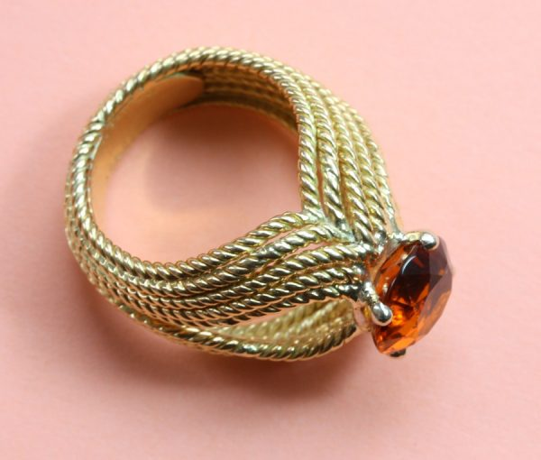 Boucheron Vintage Orange Garnet and 18ct Yellow Gold Cocktail Ring; 18ct gold rope twist ring set with 2ct brilliant cut orange garnet. Signed and numbered