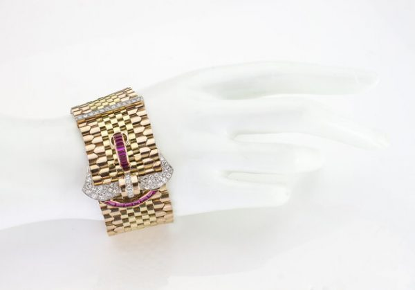 Vintage Tiffany and Co 18ct Gold Belt Buckle Style Bracelet set with rubies and diamonds. Circa 1940s.