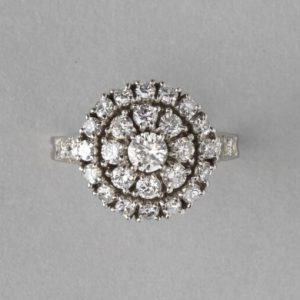 Tiffany and Co Vintage 1.75ct Diamond and Platinum Circular Cluster Ring; central 0.25ct brilliant-cut diamond stone is surrounded by two halos of diamonds, diamond set shoulders, in platinum and iridium, Signed, Circa 1950