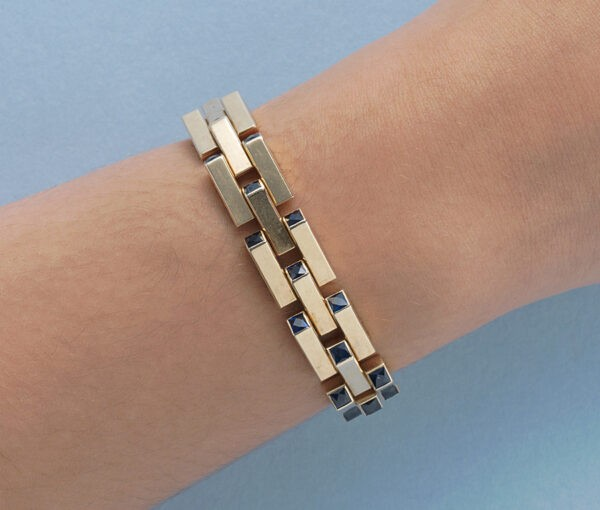 Cartier Gold Retro Bracelet Set With Sapphires; industrial design tank link gold bracelet set with thirty-one French square cut sapphires, Signed and numbered, Circa 1940