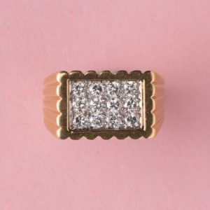 Van Cleef and Arpels Vintage 0.60ct Diamond and 18ct Gold Dress Ring; rectangular tartelette ring set with 12 diamonds, ribbed shank, Signed and numbered