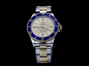 Rolex 16803 Submariner in Gold and Steel with Tropical Serti Dial
