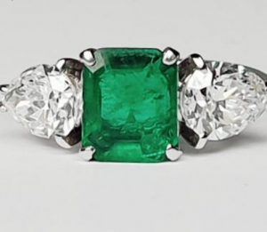 Emerald and Pear Shaped Diamond Three Stone Ring