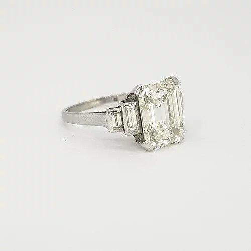Art Deco Asscher Cut Diamond and Platinum Ring; central 4ct asscher cut diamond flanked by graduated baguette cut diamond set shoulders