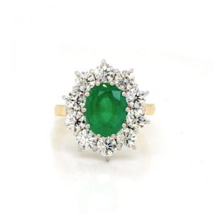 Emerald, Diamond and 18ct Gold Oval Cluster Ring, 2.15 carats