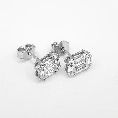 Baguette Cut Diamond Stud Earrings; central baguette-cut diamond with a baguette cut diamond surround accented with brilliant cut diamonds at each corner, 0.77 carat total, in 18ct white gold