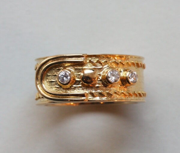 Kutchinsky Vintage Diamond and 18ct Yellow Gold Buckle Ring; geometricaland wave pattern, four buttons of which three are set with diamonds. Signed Kutchinsky, London, 1969