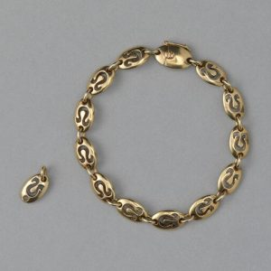 Van Cleef and Arpels Vintage 18ct Yellow Gold Leo Bracelet; chunky oval links with cut out Leo zodiac symbols. Circa 1970. Signed and numbered