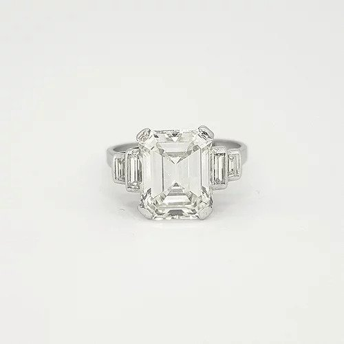 Art Deco Asscher Cut Diamond and Platinum Ring; central 4ct asscher cut diamond, estimated colour I/J and clarity VS2. Accented by two graduated baguette cut diamonds to each side