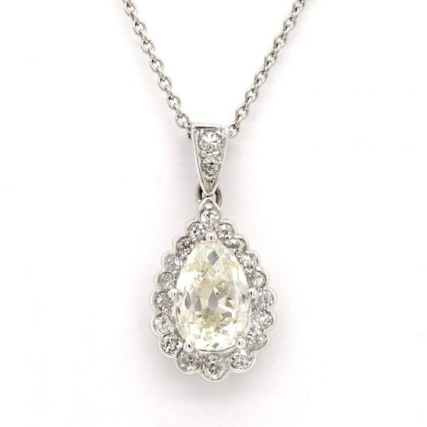 Vintage Diamond Pear Shaped Cluster Drop Pendant; central pear cut diamond surrounded by round faceted diamonds, 1.48 carat total, 18ct white gold