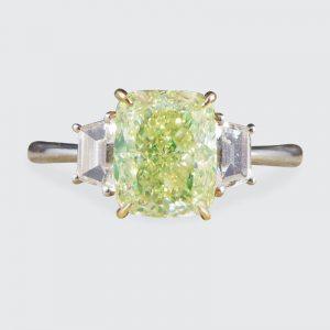 Fancy Light Green 2.40ct Diamond and White Diamond Three Stone Ring
