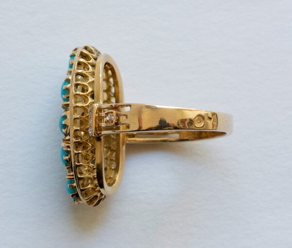 Antique Victorian Cabochon Turquoise, Diamond and Gold Oval Plaque Ring; 18ct yellow gold oval ring set with eight cabochon cut turquoises accented with nine rose cut diamonds. France, 19th century