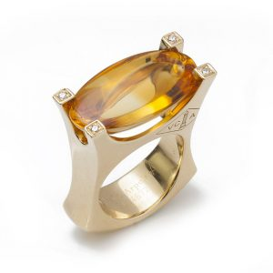 Vintage Van Cleef and Arpels Citrine, Diamond and 18ct Yellow Gold Ring; set with a large 18 carat oval cabochon citrine accented with diamond set corners to the mount, Circa 1990s
