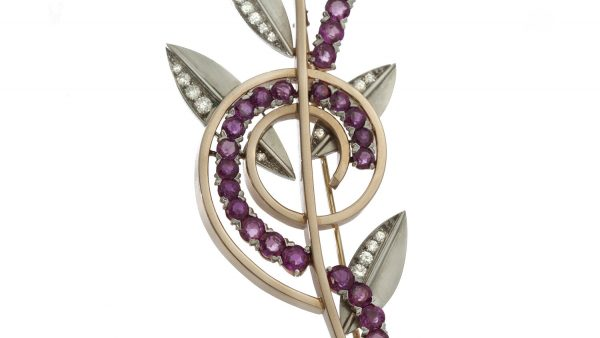 Tiffany and Co Vintage Ruby and Diamond Retro Floral Brooch, crafted from platinum and 14ct yellow gold, set with rubies and diamonds. USA, Circa 1940s