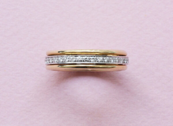 Diamond and 18ct Yellow Gold Spinning Full Eternity Ring; 18ct gold band ring with a turning inner eternity ring set with 0.40cts brilliant cut diamonds