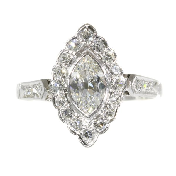 Vintage 1950s Marquise Diamond Cluster Ring; featuring a central 0.45ct marquise cut diamond surrounded by 0.40cts single cut diamonds, 0.85 carat total, mounted in platinum