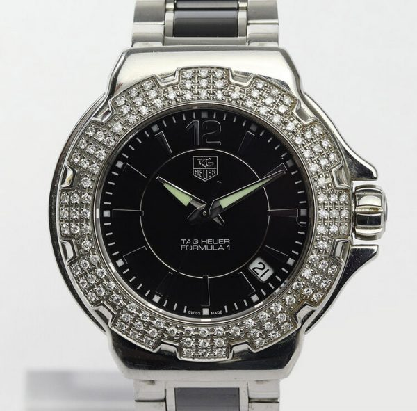 Tag Heuer Formula 1 Ladies Sparkling Diamonds Quartz Watch; Ref WAH1214-0, 36mm stainless steel case with black dial, date indicator, original diamond bezel and sapphire crystal, on a ceramic and stainless steel bracelet with push button clasp