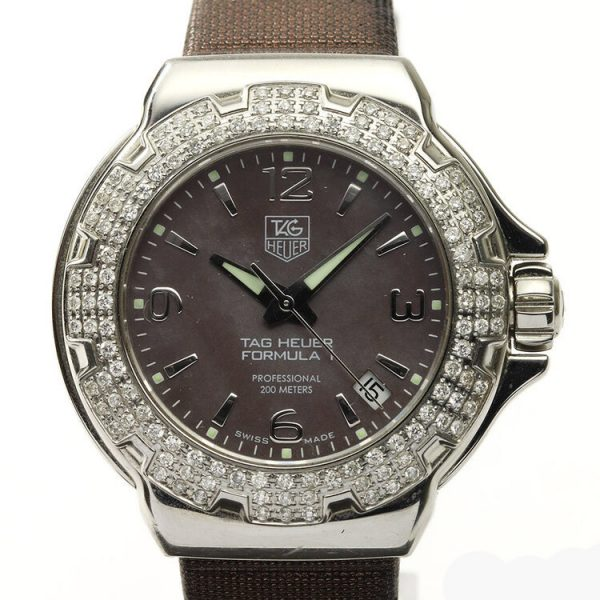 Tag Heuer Formula 1 Ladies Sparkling Diamond Bezel Mother of Pearl Dial Watch; Ref. WAC1217, 36mm stainless steel case with original diamond bezel, brown mother of pearl dial, four Arabic numerals, date indicator, screwdown crown and sapphire crystal, Quartz movement, on a TAG Heuer brown satin/leather strap with Tag Heuer buckle