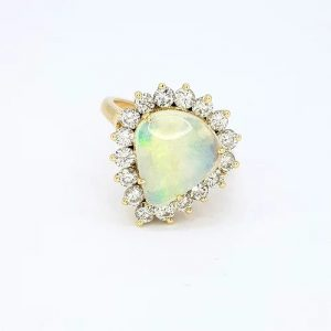 Cabochon Opal and Diamond Pear Shaped Cluster Ring