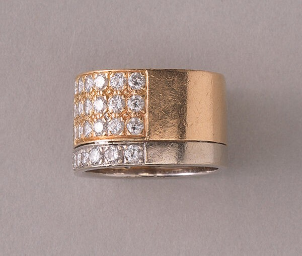Vintage Diamond and Bi Colour 18ct Gold Band Ring; 18ct yellow and white gold juxtaposed angle pavé set with 48 brilliant cut diamonds, 2.50 carat total, by the Swiss master jeweller Paul Binder. Circa 1970s, Zurich, Switzerland