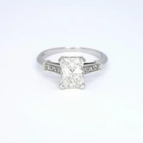Radiant Cut Diamond Solitaire Engagement Ring; featuring a 1.18 carat radiant-cut diamond, accented with diamond set shoulders, in platinum