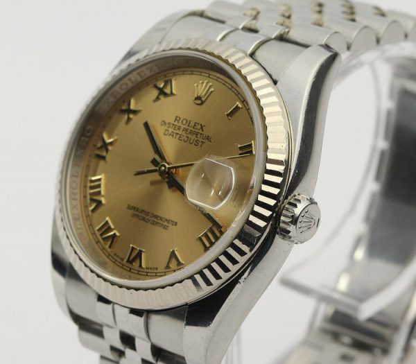 Rolex Datejust 36mm Stainless Steel Automatic Watch with White Gold Bezel and Champagne Dial, ref 116234, on a stainless steel Jubilee bracelet with Crown clasp, Circa 2008-09