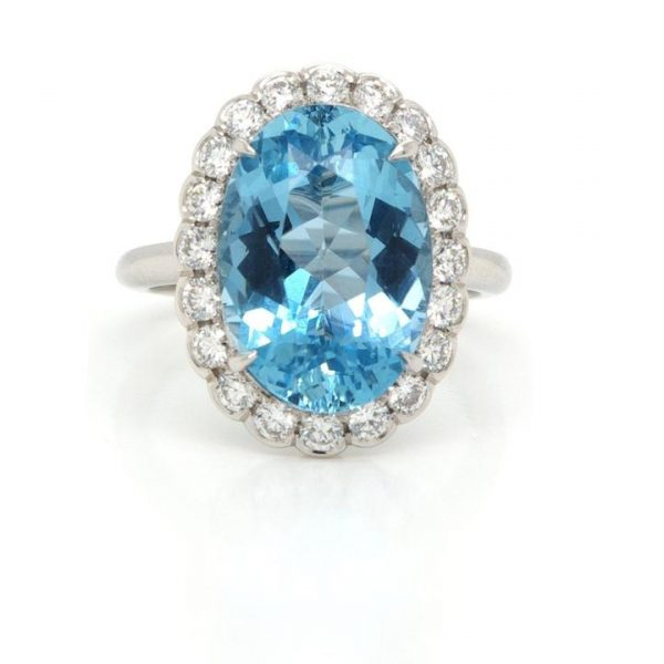 Aquamarine and Diamond Oval Cluster Ring; featuring a 5.33 carat oval faceted aquamarine surrounded by 0.68cts collet-set brilliant cut diamonds, mounted in platinum