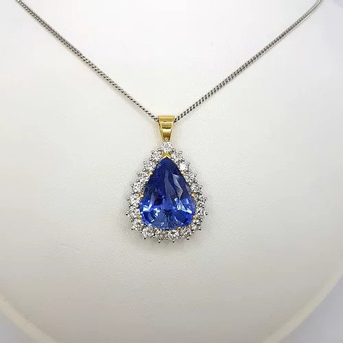 Natural Sapphire and Diamond Pear Cluster Pendant; featuring a 8.58 carat natural pear cut sapphire from Madagascar with 2cts brilliant diamond surround, Certified