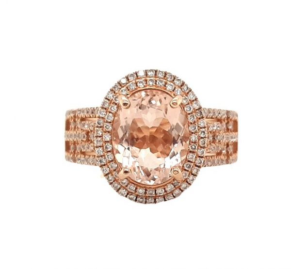 David Jerome 2.54ct Oval Morganite and Diamond Cluster Dress Ring in 18ct Rose Gold; central 2.54 carat oval faceted morganite accented with a double diamond surround and diamond set geometric pierced shoulders