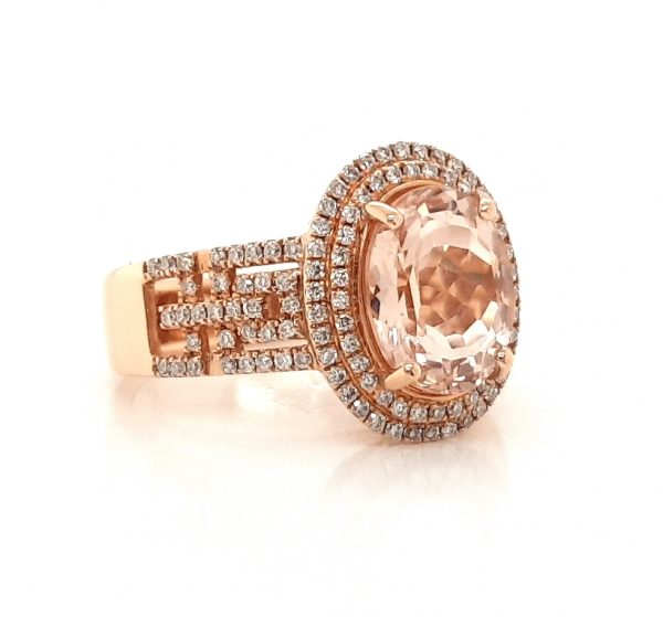 2.54ct Oval Morganite and Diamond Cluster Dress Ring in 18ct Rose Gold; central 2.54 carat oval faceted morganite accented with a double diamond surround and diamond set geometric pierced shoulders