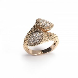 Boucheron Serpent Boheme Diamond Ring; formed of two pear-shaped sections pavé set with sixteen round brilliant-cut diamonds, 0.65cts, in a cross-over design, scale-like detailing to 18ct rose gold shank. Stamped Boucheron with number OR2465. Circa 2010