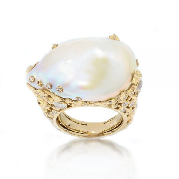 Bibi Van Der Velden Pearl Moonstone Diamond Ring; featuring a large baroque pearl encased in an 18ct yellow gold setting shaped into clusters of stars and set with moonstones and diamonds