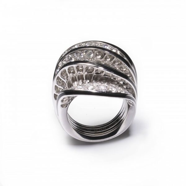 Cartier Paris Nouvelle Vague Diamond and Enamel Cocktail Ring; pavé set with 5.00 carats of round brilliant-cut diamonds in five wave-shaped formations, the edges with black enamel accents, in 18ct white gold, Signed
