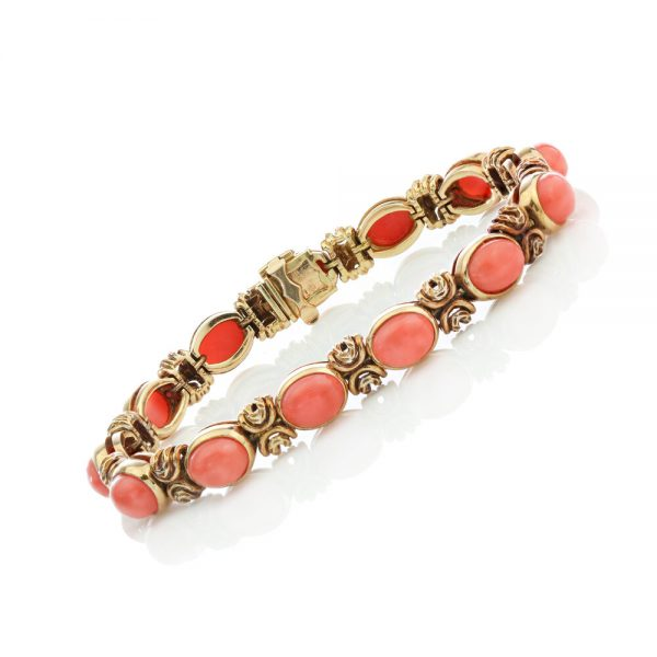 Van Cleef and Arpels Vintage Coral and 18ct Gold Bracelet; set with oval cabochon-cut coral. Made in France, Paris, Circa 1970s