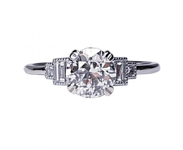 Vintage 1.06ct Old Cut Diamond and Platinum Engagement Ring; featuring a 1.06 carat G colour VS1 clarity old European transitional cut diamond with baguette and radiant-cut diamond shoulders, in platinum