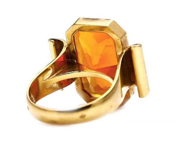 Vintage French Fire Opal Cocktail Ring; striking mid-century dress ring featuring a large 8.00 carat emerald-cut fire opal of 8.00 carats, in 18ct yellow gold mount with scrolled shoulders
