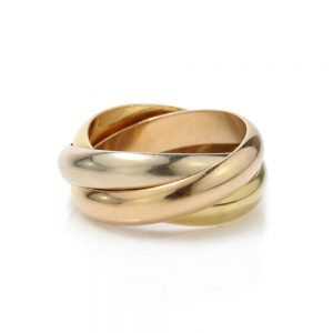 Cartier 18ct Gold Trinity Ring; comprised of three interlocking gold bands, Made in 1997, Signed